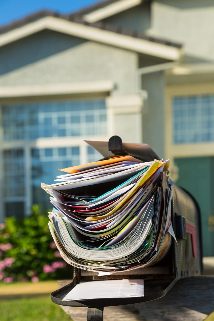 picture of a cluttered mailbox of an unoccupied home
