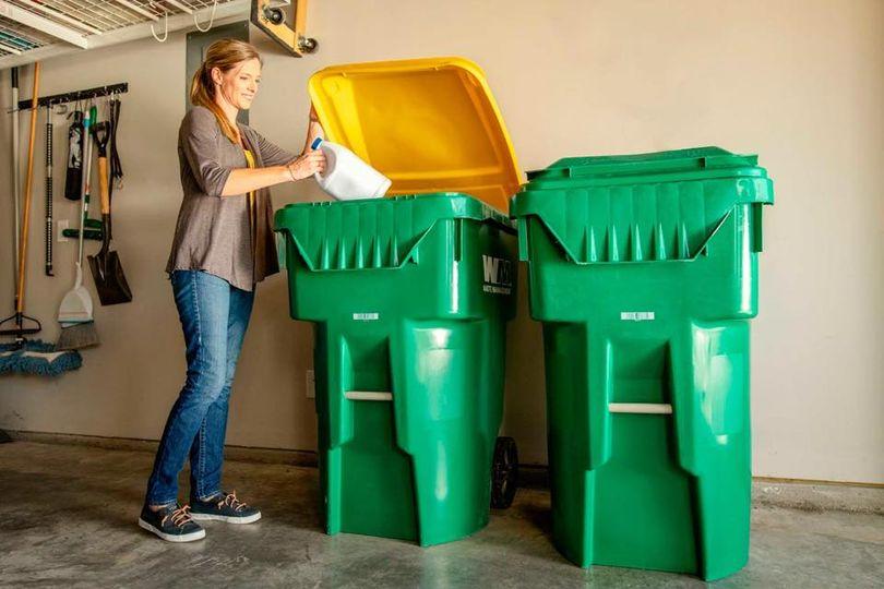 women throwing away trash into a trash bin